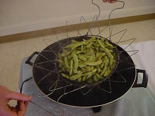 Photo of edamame being immersed in boiling water